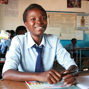 Plan school in Mali-smiling-girl-at-desk